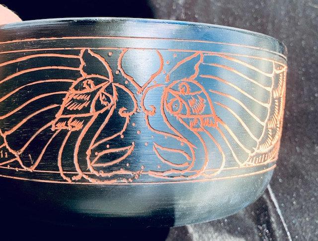 black buddah singing bowl
